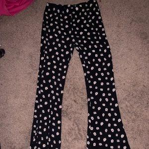 Black flower bell bottom leggings.